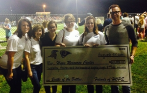 HOPE staff with the check for $20,188.44!!